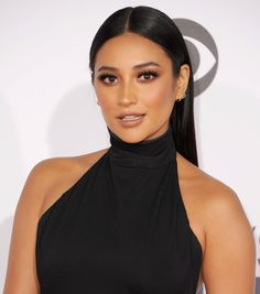 Shay Mitchell resembles Kylie Jenner with lush lashes, brown towns and slicked back hair