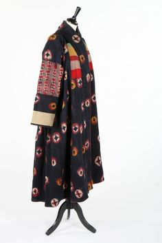 * Tie-dyed homespun Shambu wool woman's coat, Tibetan, circa 1930. with pink and yellow roundels against an indigo ground, patchworked chest panels, the back with large panel of floral chintz -