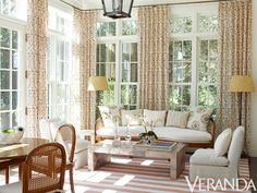 SIMPLY CHARMING: Small Pattern Design Ideas--Small-scale prints in vibrant oranges enliven a sun room, complementing the room's light, airy feel. (Interior by Timothy Whealon)