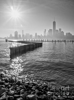 The Freedom Tower and lower Manhattan skyline of New York City rises above the Hudson River on a hazy morning as seen from Jersey City, NJ. Presented in an elegant monochrome processing. Nyc Skyline, Manhattan Skyline, Lower Manhattan, The Freedom Tower, Fine Art Photography, Fine Art America, Photo Art, Monochrome, Gramercy Park
