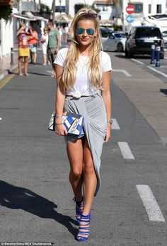 Showing some skin: Georgia slipped into a grey asymmetric skirt which exposed almost the full lengths of her toned and tanned legs