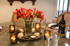 Fall Centerpiece for a rustic chic tablescape.  Orange-Red Calla Lillies, white pumpkins and twig decor balls with gold and horn accents | Redefining Domestics