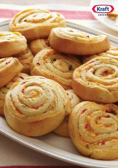 Pimento-Cheese Pinwheels — These rolled pinwheels look like loads of fun, but it's the cheese and kick from a dash of hot pepper sauce that make this appetizer recipe so popular.