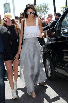 Sally LaPointe skirt cascades on the street thanks to a cape-like finish, and it works double-duty, providing lightness and maximum breath ability. While Jenner paired the piece with a lattice-like 3.1 Phillip Lim crop top