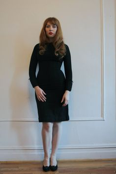 I love a simple black long-sleeved dress.