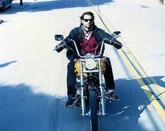 Lorenzo-Lamas-As-Reno-Raines-Riding-Bike-On-Freeway-Renegade-8x10-Photo