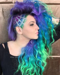 Amazing!! Loving this mermaid long hair!! Guy Tang mixed purple, blues and green to create this awesome crimped style. Added glitters and side cuts for a intricate and chic look!