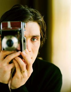 Cillian Murphy, curly haired + long side part.