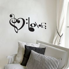 "Music Notes Spelling Love Wall Decal Vinyl Art Sticker 10.5""h X 20""w. $19.99, via Etsy."