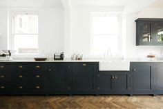 The Bath Shaker kitchen from deVOL. Love the colour against the dark oak parquet floors. For more inspiration visit www.thehousedirectory.com