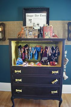 the cutest! dog chest made from chest, top drawers taken out, rod added in.... i totally need this! :)