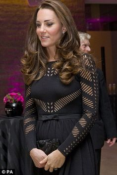 All wrapped up: A small, neat bow on her Temperley dress accentuated her new bump
