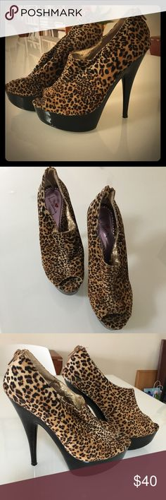 Hot leopard print open toe platforms These are... So. Much. Fun!!! Who doesn't need a pair of leopard print platforms to wear with a pencil skirt or to spice up a work suit?!?! C'mon... you know you want them. Shoes Platforms