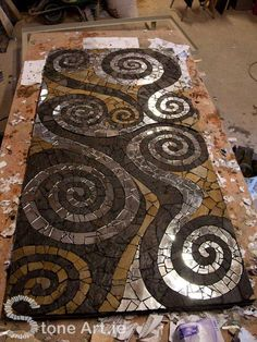 A mosaic table using the same technique. Visit Sunny's site at http://www.stoneart.ie/ to see more wonderful examples of his work.  on The Owner-Builder Network  http://theownerbuildernetwork.co/wp-content/blogs.dir/1/files/mosaic/Mosaic-3.jpg