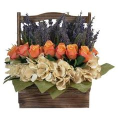 "With faux hydrangea, roses, and lavender flowers in a handled wood basket, this lovely arrangement brings a touch of natural style to your decor.    Product: Faux floral arrangementConstruction Material: Silk, plastic and woodColor: Purple, orange, creme and greenFeatures: Includes faux hydrangea, roses and lavenderDimensions: 14"" H x 12"" W x 12"" D Note: For indoor use only"