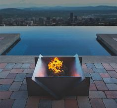 Stahl Firepit -- The American-made Stahl Firepit will add the warm glow of a wood fire & stylish design to your outdoor chill zone. Made of 5 precision cut, heavy gauge metal plates, it is quick & easy to assemble with no tools or hardware. Also available in all Aluminum construction.