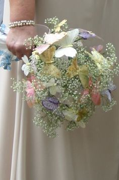 Butterfly Wedding Bouquet- I like this with baby's breath but I am thinking I will use different flowers and fewer butterflies in jewel tones.