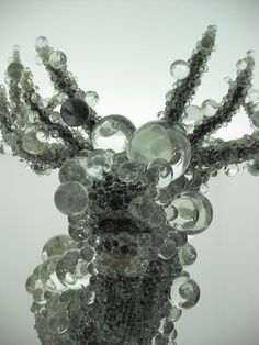 artist, Kohei Nawa, reminds us that everything is made of smaller parts.  Similarly, the real animal is made of molecules, and what we see is actually a distortion created by our limited vision.  cover objects with glass beads, amplifying the idea that what we see is actually a distortion of the smaller parts that the object is made of.