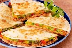 Crunchy Quesadilla Stack: Refried beans, spicy tomatoes, cheese, and avocado layered in tortilla and crunchy corn tostadas. Would be great with a yellow corn tortilla for a GF option Mexican Dishes, Mexican Food Recipes, Vegetarian Recipes, Dinner Recipes, Cooking Recipes, Healthy Recipes, Skillet Recipes, Lunch Recipes, Think Food