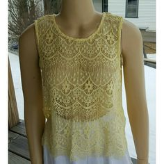 Lace Top This very delicate lace top is super cute!  Wear a spaghetti strap underneath because it's see-through.  Dress up or dress down,  this piece will for sure start a conversation...  Worn,  but no sign of it.   Medium,  baby yellow.   Approximate measurements:  Bust  36 Length 21 Forever 21 Tops