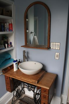 Singer sewing machine converted to bathroom vanity.