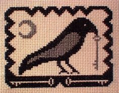 Olde Crow Cross Stitch Pattern - This silver-winged crow has a mystery on his mind as he dangles an old skeleton key from his beak. With only two colors of floss, and a stitch count of 49 stitches high by 63 stitches wide, this is a simple project that can be completed quickly and easily, no matter what your experience level.