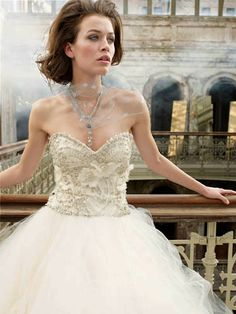Ivory tulle bridal ball gown, sweetheart neckline, beaded and embroidered bodice with silk chiffon flower accents, dropped waist, circular tulle skirt, chapel train. It has a fairy tale feel with a full skirt yet the sweetheart neckline and detailing keep it feeling vintage and elegant. $999.00. Order at:http://www.999weddingdress.com.au/products/999-wedding-dress-belle