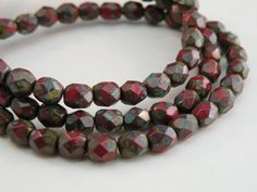 Red opaque mottled with green brown Picasso finish Czech glass beads by Sparkling Sisters Jewelry Supplies on Etsy, $3.95