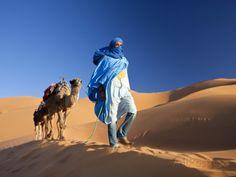 Tuareg Man Leading Camel Train, Erg Chebbi, Sahara Desert, Morocco