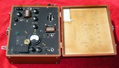 The Famous American PRC-5 SPY RADIO TRANSCEIVER: This is the classic suitcase spy transmitter-receiver used during WW-2. and what Michael used