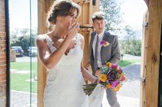 Abigail wore a backless Pronovias gown for her colourful Summer wedding at Shustoke Barn. Photogrpahy by Ria Beth.