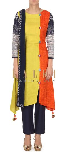 Buy this Yellow printed straight suit adorn in fancy button only on Kalki