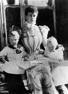 The Duchess of York (1869 - 1953), Mary of Teck, later Queen Mary, wife of George V, with her children, Prince Edward (Duke of Windsor) and Prince Albert (King George VI)