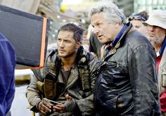 Pin for Later: Mad Max's Fierce Pictures Prove This Movie Needs to Be on Your Must-See List Hardy and director George Miller on the set.