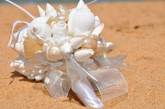 Our sample Seashell Bouquet resting on Avoca Beach's golden sand. This one has been sold