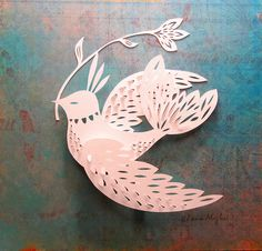 Cut Paper Bird by Claire Mojher, via Flickr