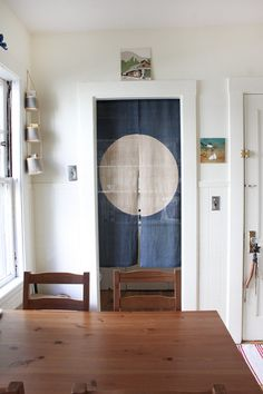 Julia Okun's home. Love the door curtain.