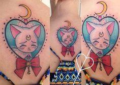 Sailor Moon Artemis tattoo.