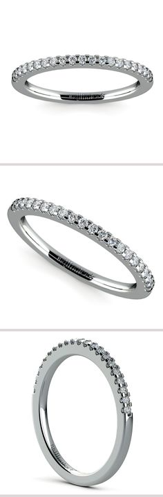 Twenty one round cut diamonds are prong set in this 14k or 18k white gold diamond wedding band.
