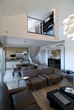 dont love the details but the open plan feeling kitchen looking into family room