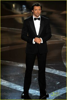 The tux does not make Hugh Jackman look good.  Hugh Jackman makes the tux look good!!  ;-)