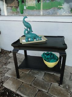 Simple end table in a soft black with moderate distressing. Modern Vintage