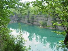 Discover Empire Quarry in Bloomington, Indiana: A stunning, abandoned limestone quarry in southern Indiana provided the stone to erect the Empire State Building. Limestone Quarry, Empire State Building, Day Trips, Indiana, Abandoned, Sunrise, Places To Visit, Explore, Adventure