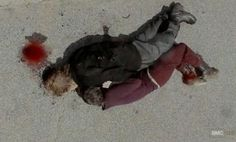 Carol (Melissa McBride uses Axle (Lew Temple) as a shield in Episode 10 of AMC's The Walking Dead