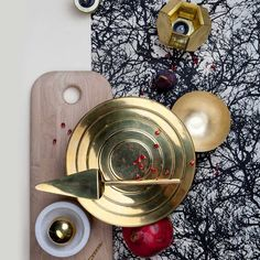 Metallic tableware such as Tom Dixon's 'Form' plates set a decadent tone for a Christmas party (tomdixon.net)
