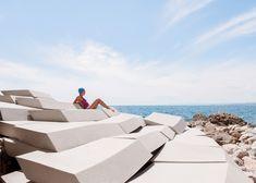 Smarin scatters foam blocks on beach for Cannes Film Festival