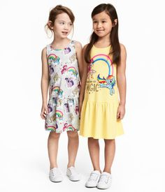 $18 - Light yellow/My Little Pony. Sleeveless dresses in cotton jersey with a printed design. Seam at hips and gathered skirt.