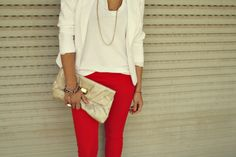 Red pants. White shirt.