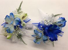 Wrist Corsages: Alstroemeria-tipped w/blue paint, Baby's Breath, Plumosa Fern.  I don't like to dye flowers unnatural colors, but it was strongly requested for this. NJROTC Military Ball