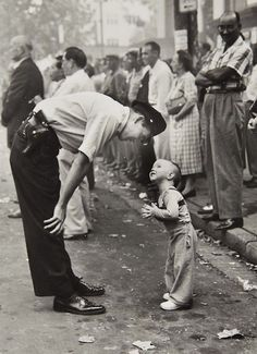 """William C. Beall, """"Faith and Confidence, 1958"""" A policeman speaks to a young boy at a parade in Washington, D.C. for the Washington Daily News. 1958 Pulitzer Prize for Photography - Courtesy Scripps Howard News Service"""